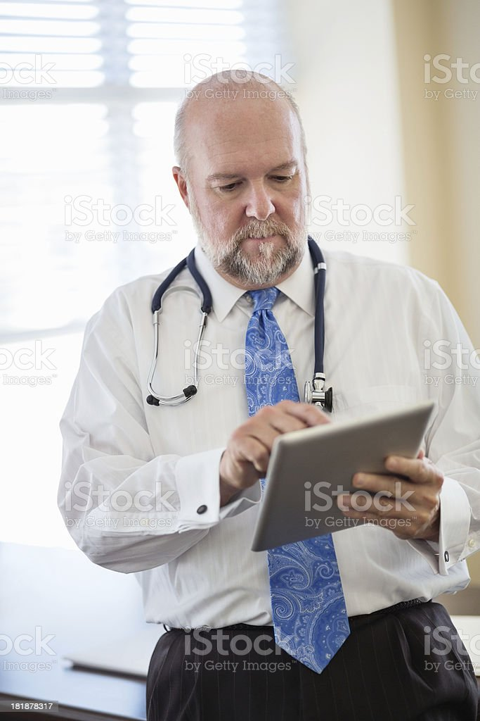Doctor With Stethoscope Using Digital Tablet royalty-free stock photo