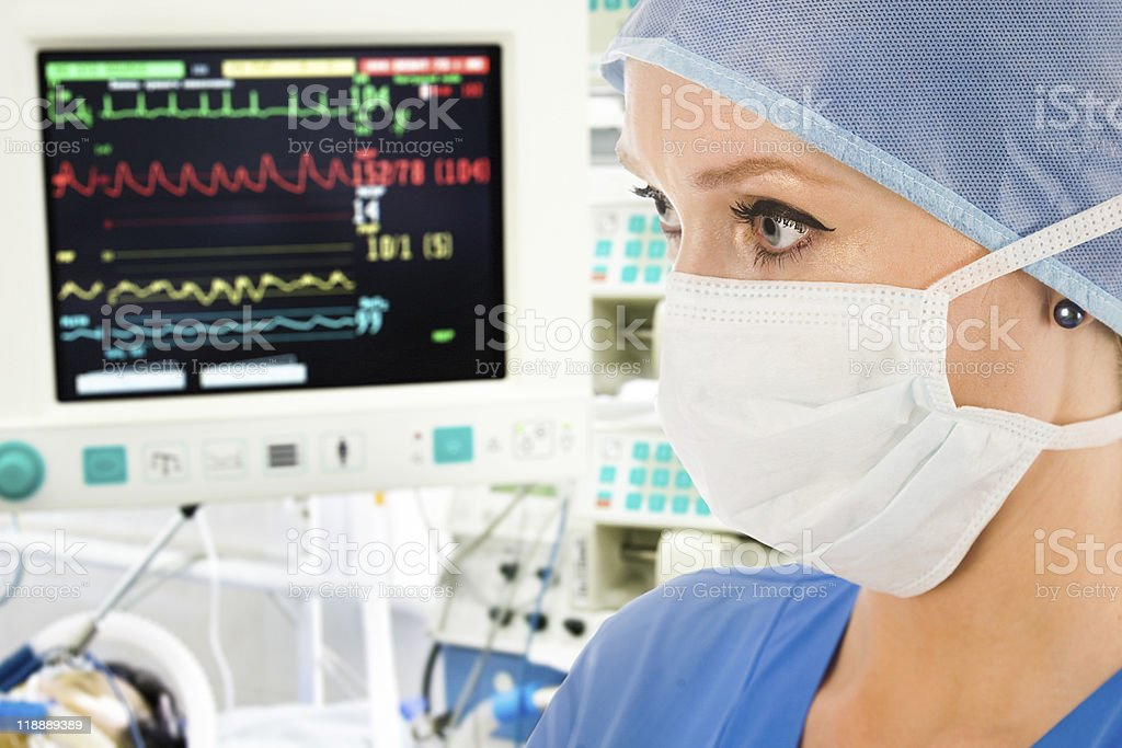 Doctor with surveillance monitor stock photo