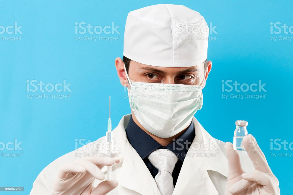 Doctor with Syringe and Flu Vaccine stock photo