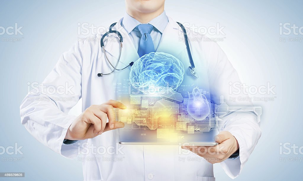 Doctor with tablet pc stock photo