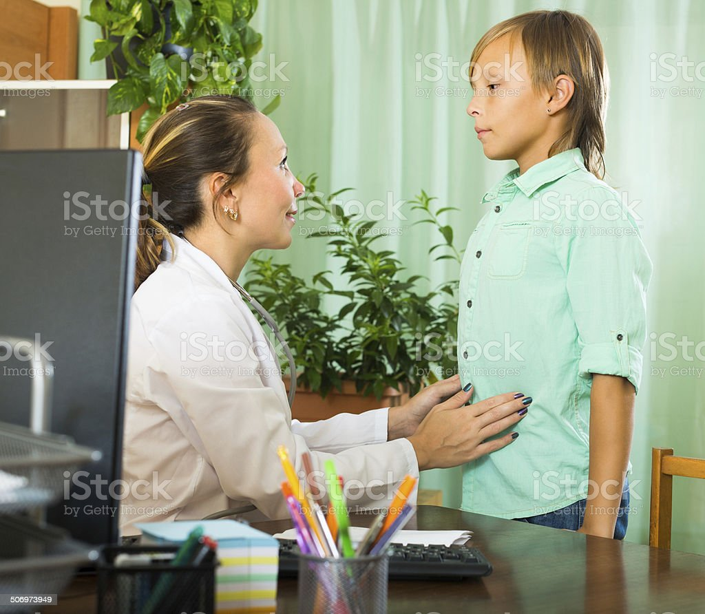Doctor with teenage boy patient stock photo