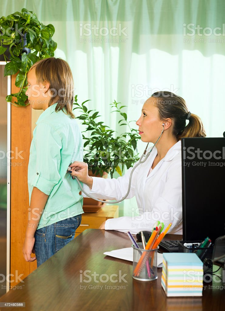 Doctor with teenager patient stock photo