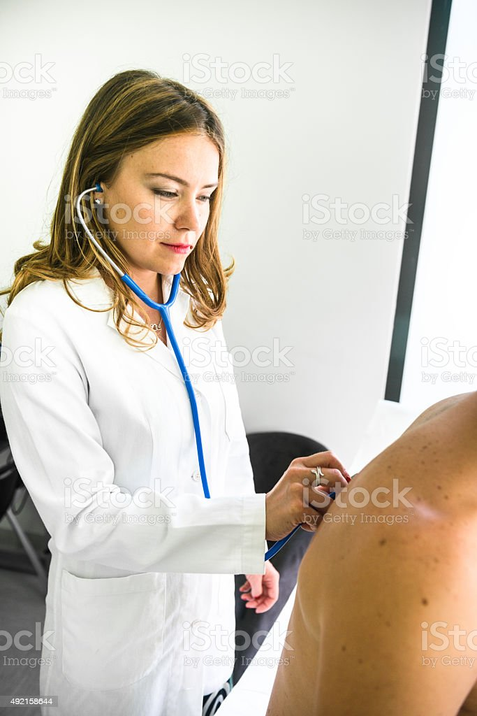 Doctor with the stethoscope doing the medical exam
