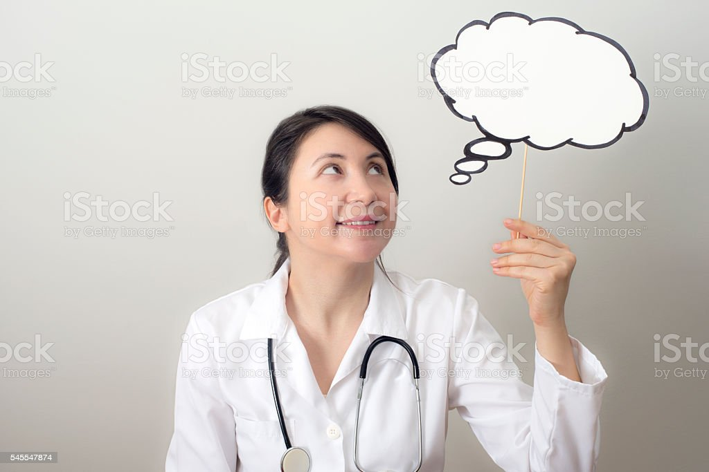 Doctor with Thought Bubble stock photo