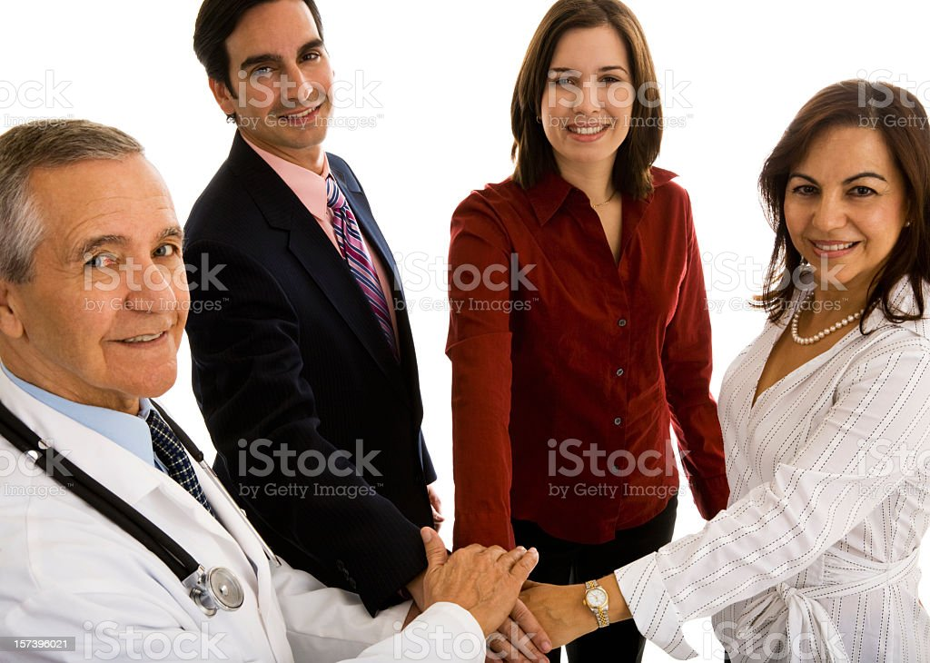 Doctor with three businesspeople hands stacked in center royalty-free stock photo
