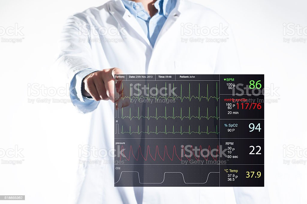 Doctor with touch screen ECG stock photo