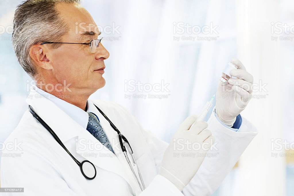 Doctor with vaccine. royalty-free stock photo