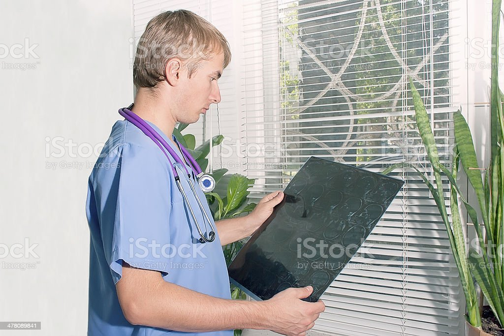 Doctor with x-ray image in his hands royalty-free stock photo