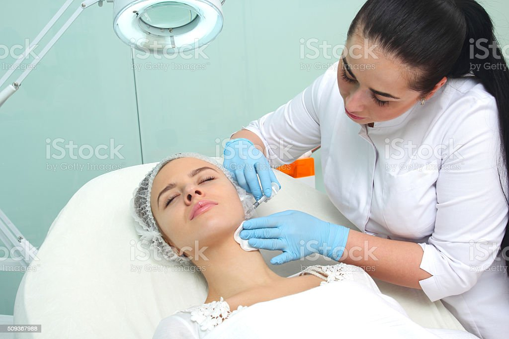 Doctor woman giving botox injections. royalty-free stock photo