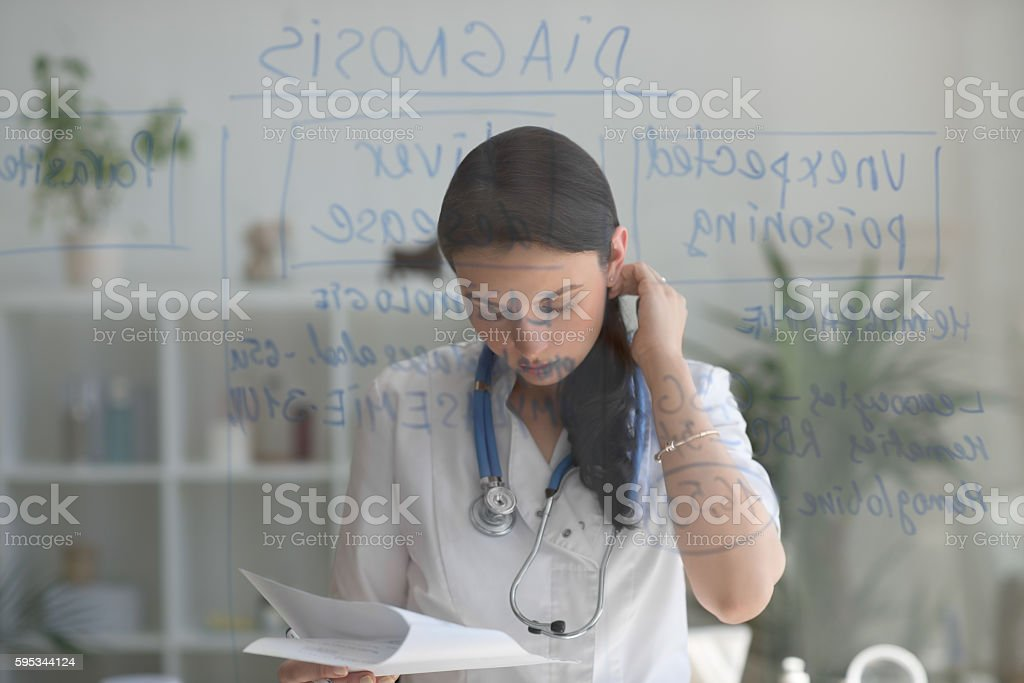Doctor working at office stock photo