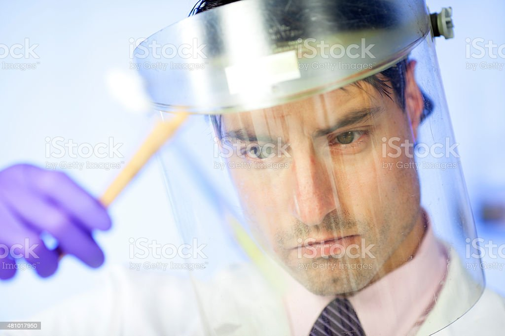 doctor  working at the laboratory examining stock photo