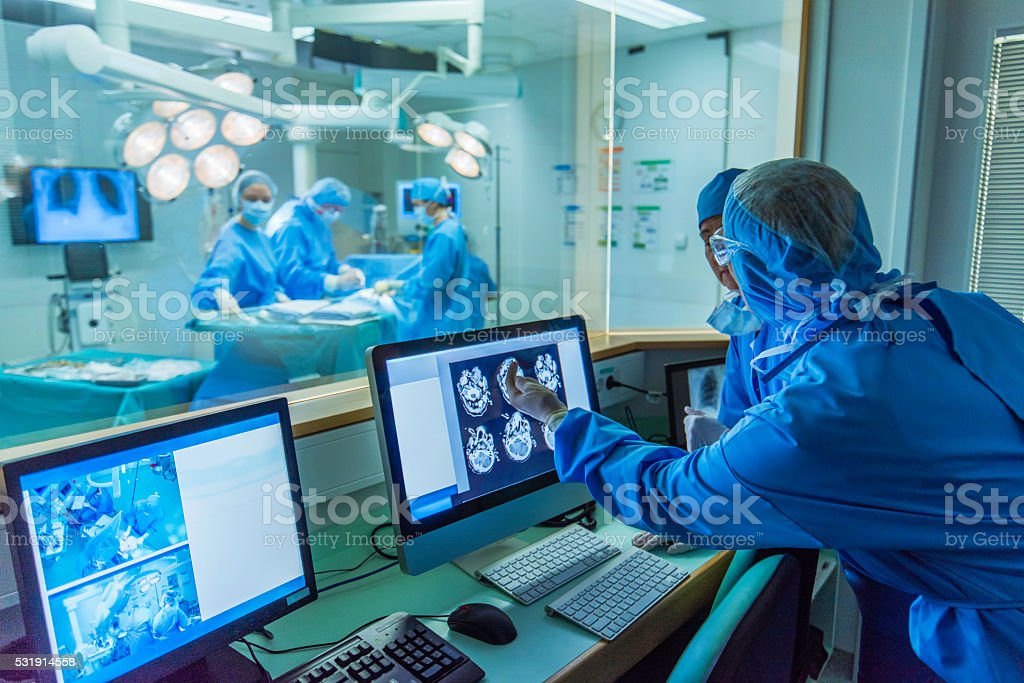 Doctor working in hospital control room stock photo
