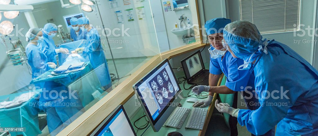 Doctor working in hospital's control room stock photo