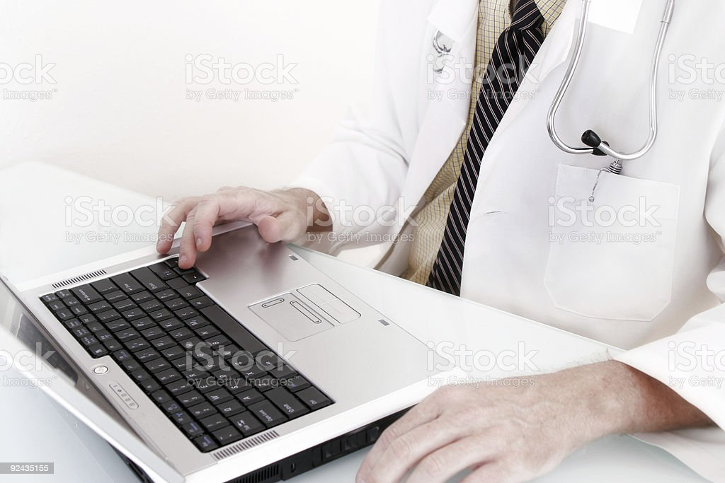 Doctor working on a laptop stock photo