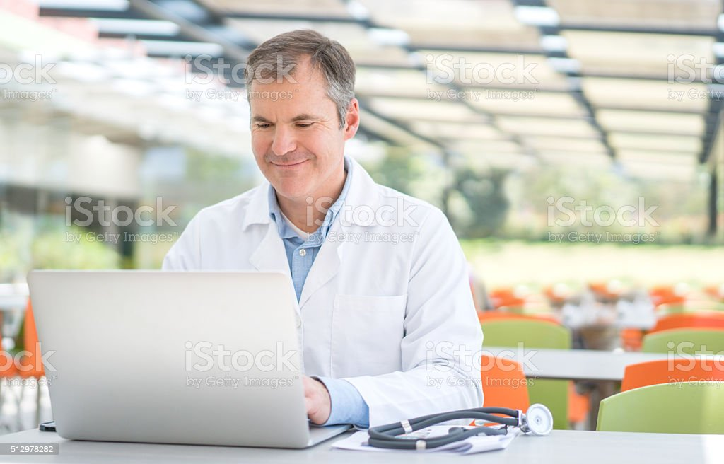 Doctor working on the computer stock photo