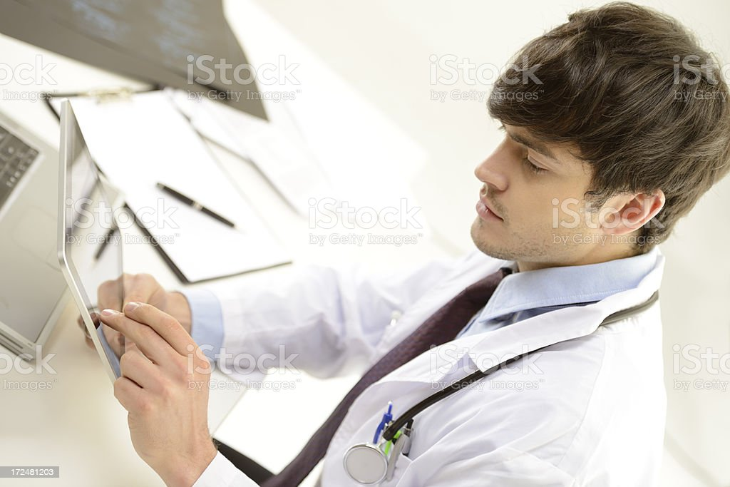 Doctor working with digital tablet royalty-free stock photo