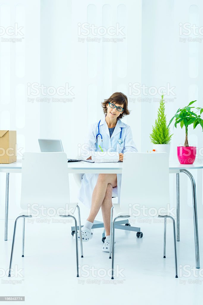 Doctor working with laptop royalty-free stock photo