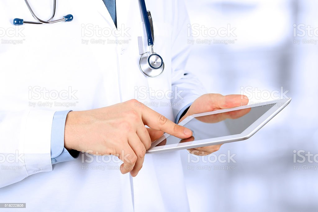 Doctor working with tablet computer. stock photo