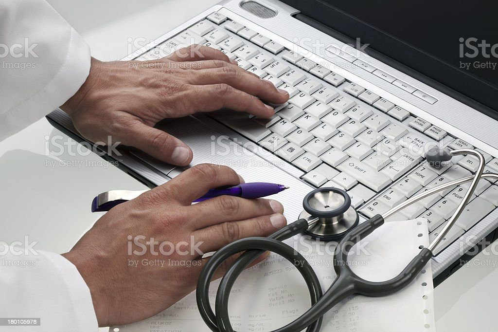 Doctor Works On Medical Exam royalty-free stock photo
