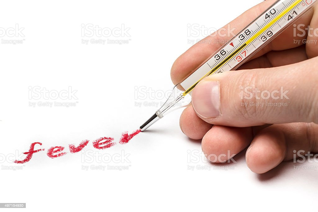 Doctor writes 'fever', using instead of a pen medical thermomete stock photo