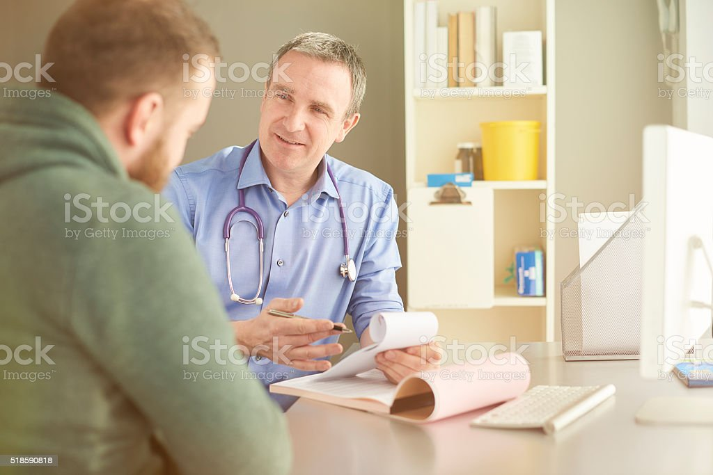 doctor writing a prescription stock photo