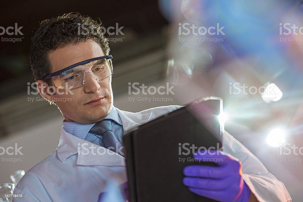 Doctor Writing Notes with Digital Tablet royalty-free stock photo