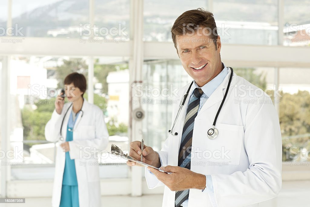 Doctor Writing on a Clipboard royalty-free stock photo