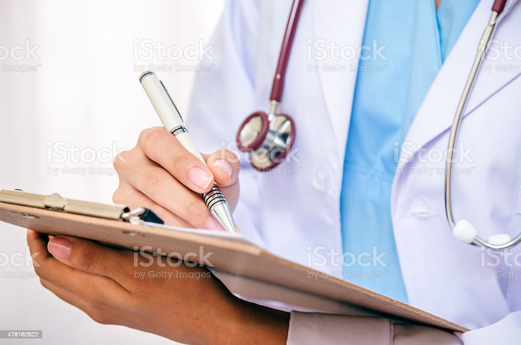 Doctor writing stock photo