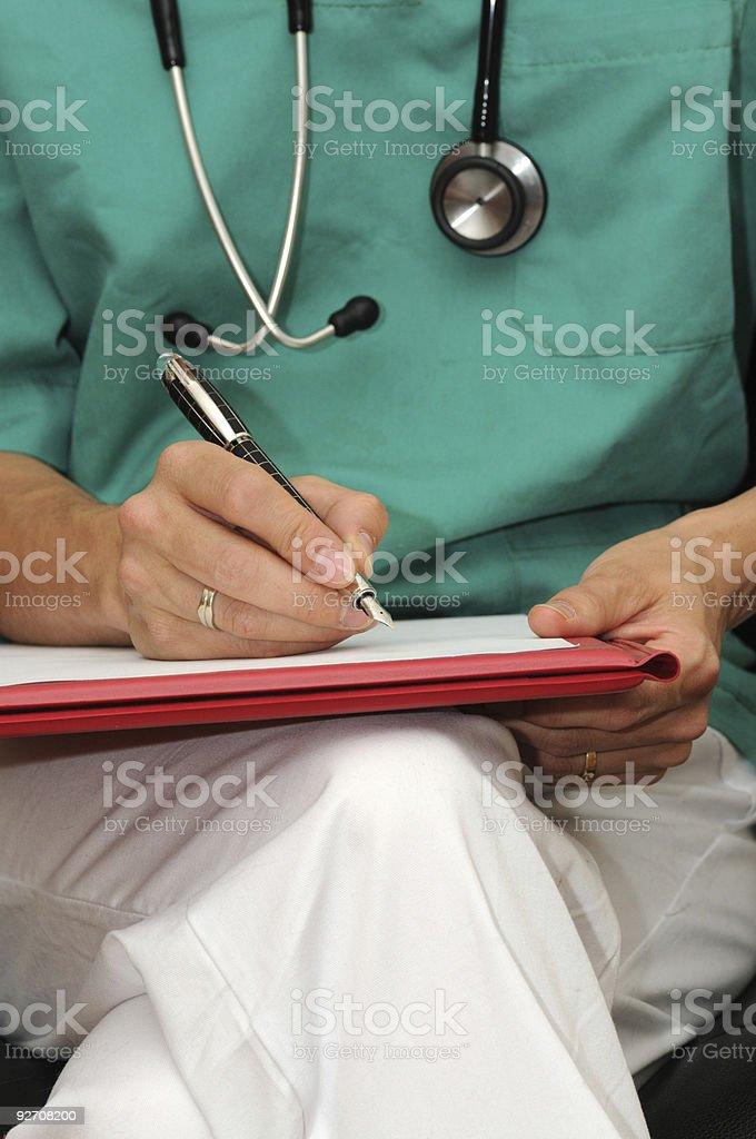 Doctor writing stock photo