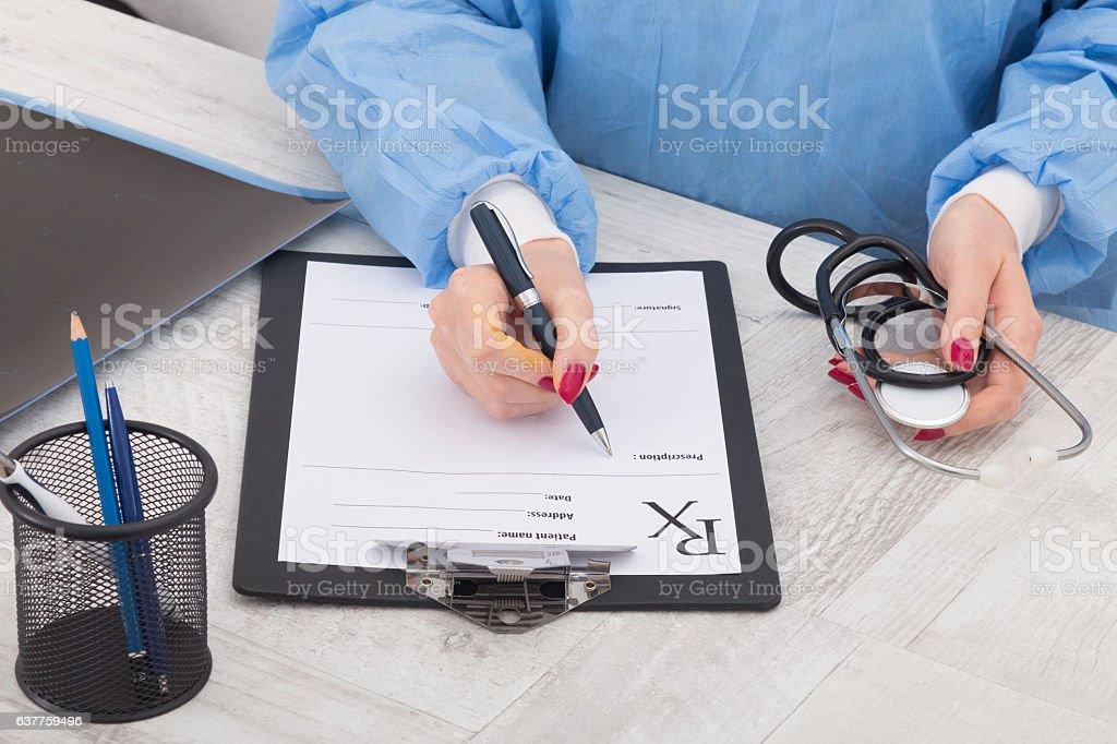 doctor writing prescription paper stock photo
