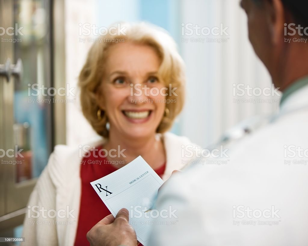Doctor Writting RX Prescription stock photo