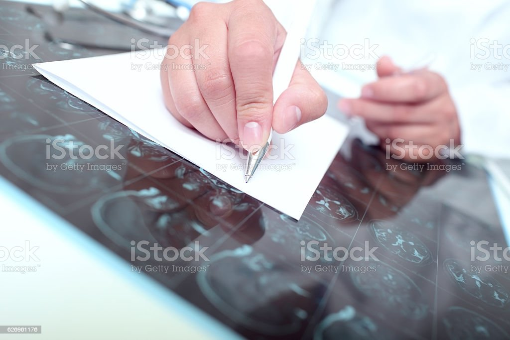 Doctor wrote on a paper stock photo