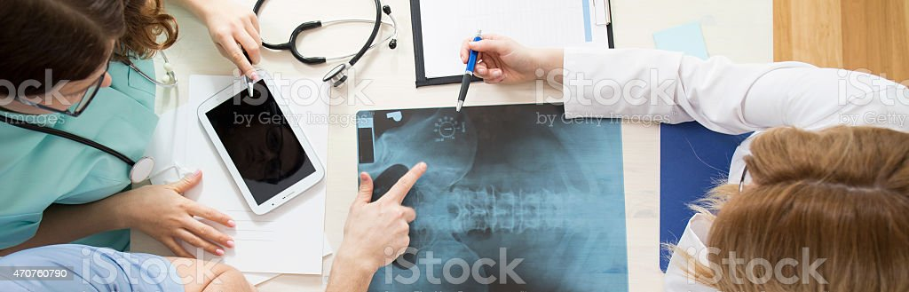 Doctors analyzing pelvis x-ray stock photo