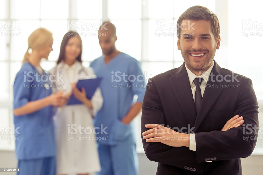 Doctors and businessman stock photo