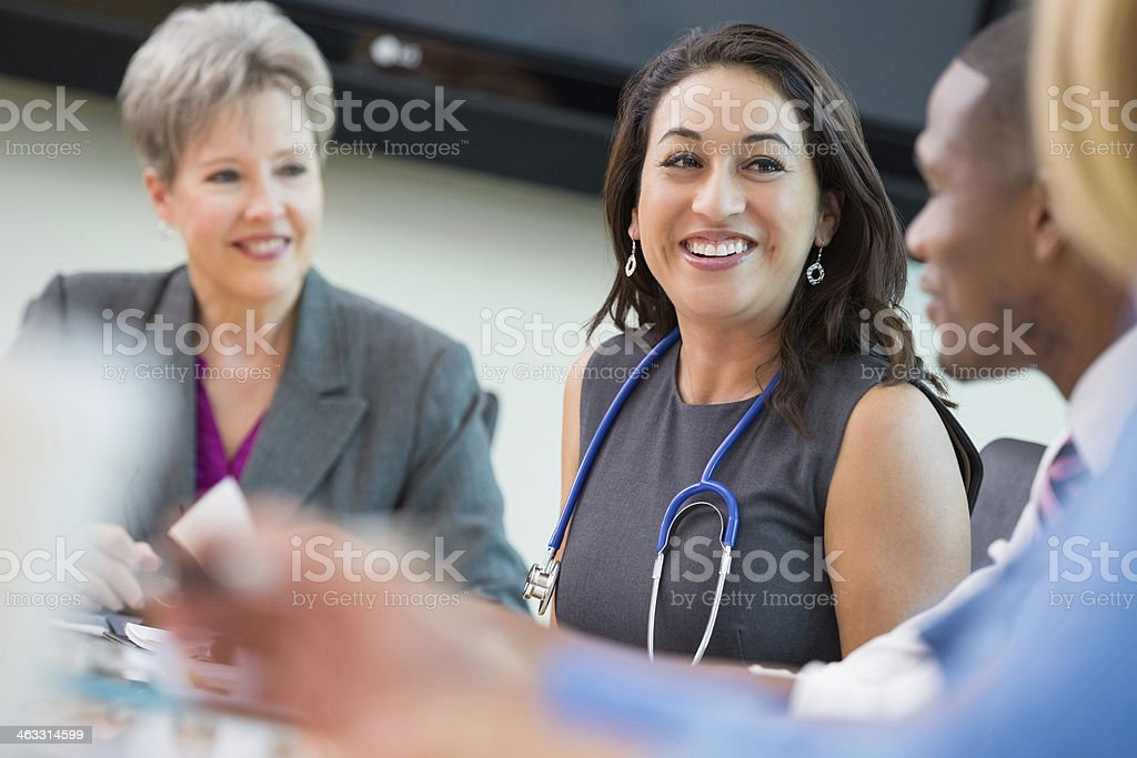 Doctors and hospital executives meeting to discuss healthcare policy stock photo