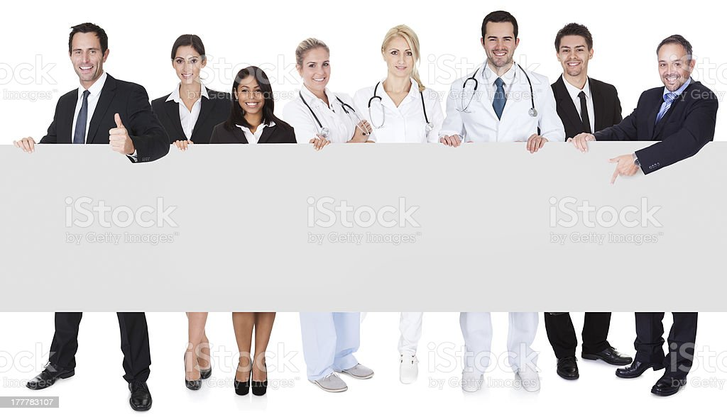 Doctors and managers presenting empty banner royalty-free stock photo