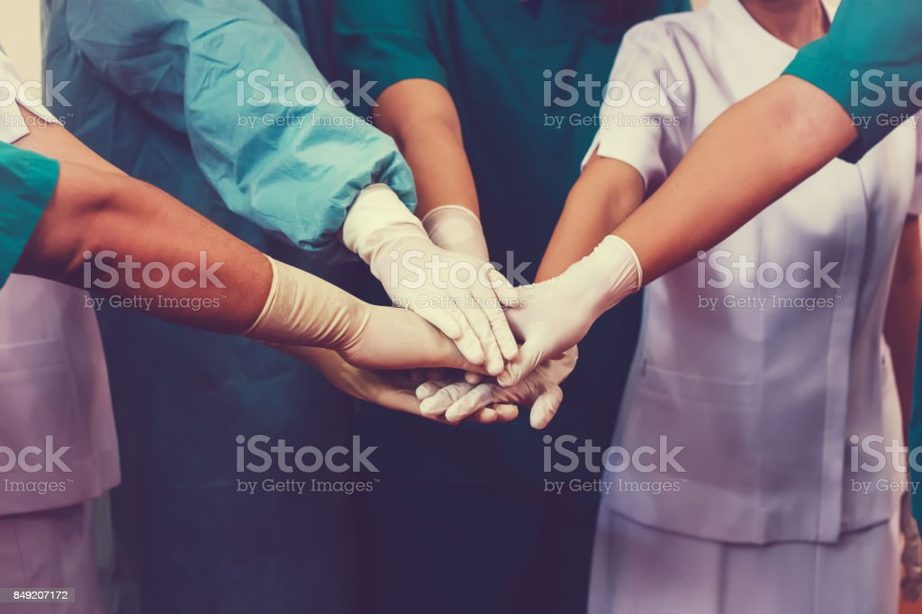 Doctors and nurses coordinate hands. Concept Teamwork stock photo