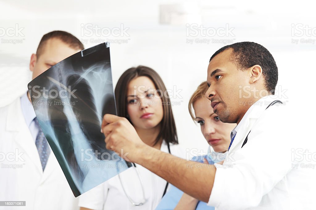 Doctors and nurses looking at x ray. stock photo