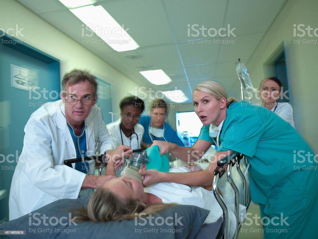 Doctors and nurses rushing with patient in hospital royalty-free stock photo
