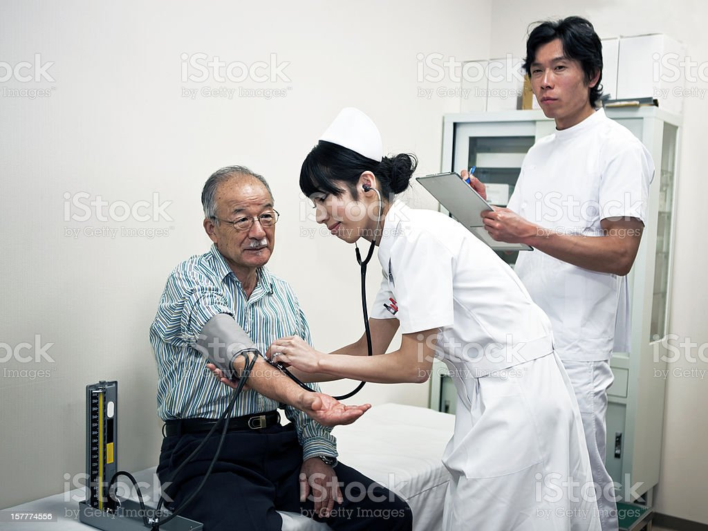 Doctors and old patient royalty-free stock photo