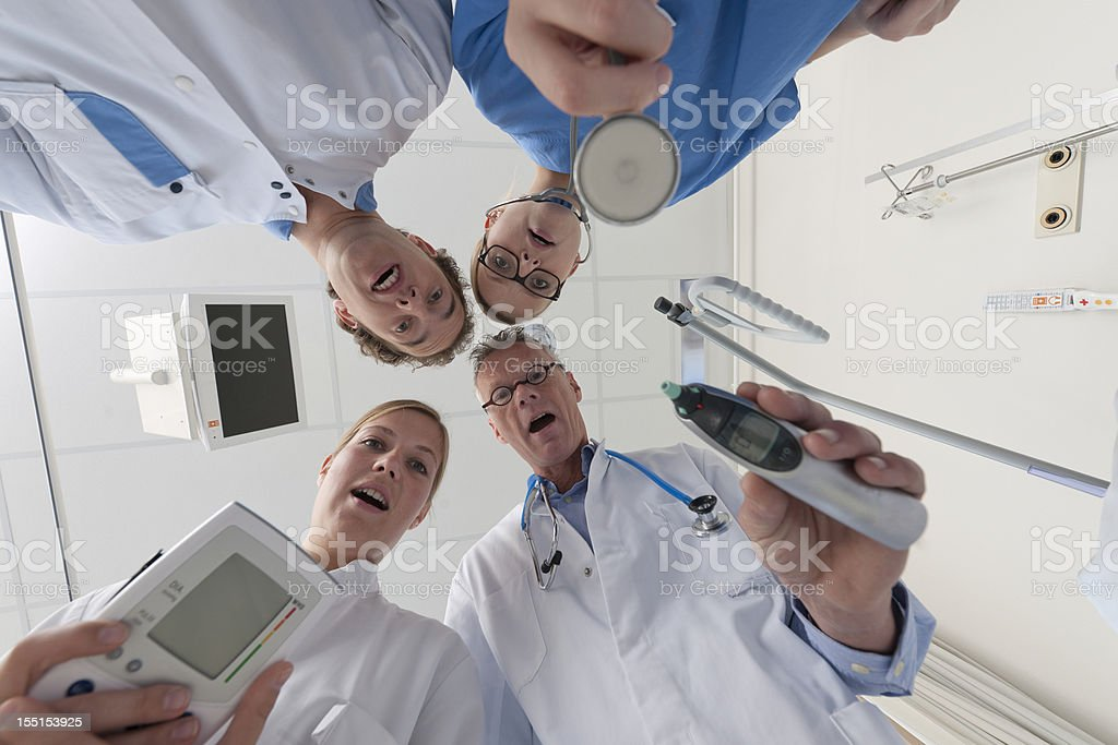 doctors and surgeon checking on patient royalty-free stock photo