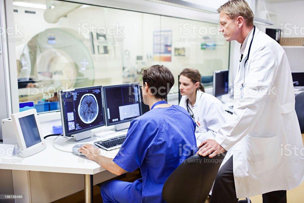 Doctors at a computer tomography exam stock photo