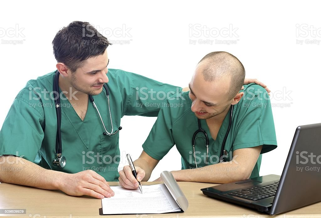 Doctors at office stock photo