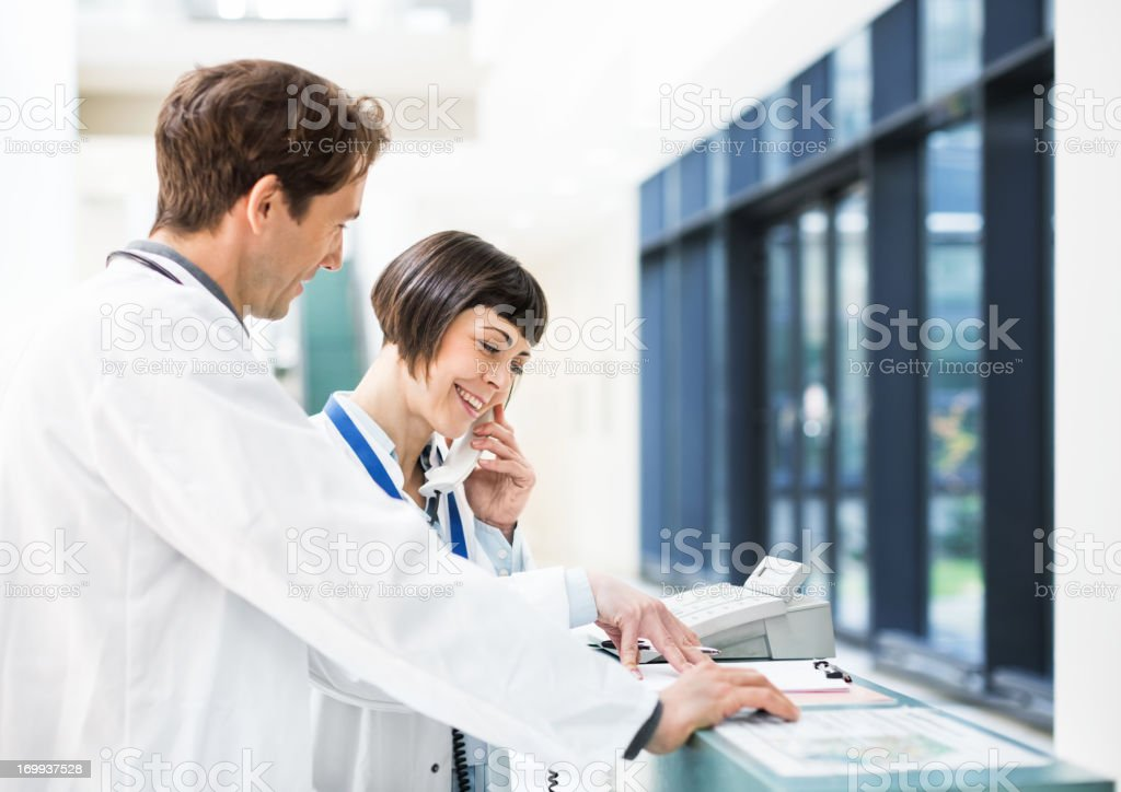 Doctors at Reception Desk royalty-free stock photo