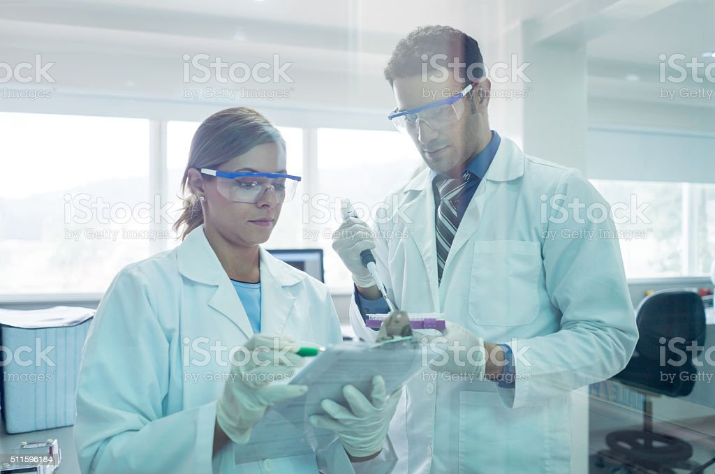 Doctors at the laboratory doing medical tests stock photo