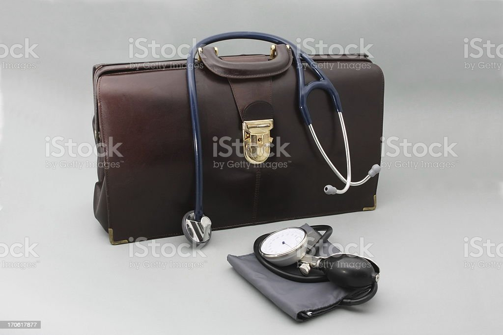 Doctor's bag with stethoscope on a gray background stock photo