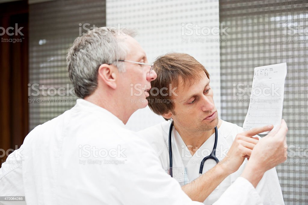 Doctors checking Echocardiogramm royalty-free stock photo