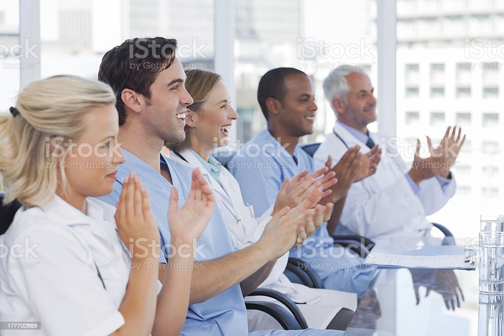 Doctors clapping their hands royalty-free stock photo