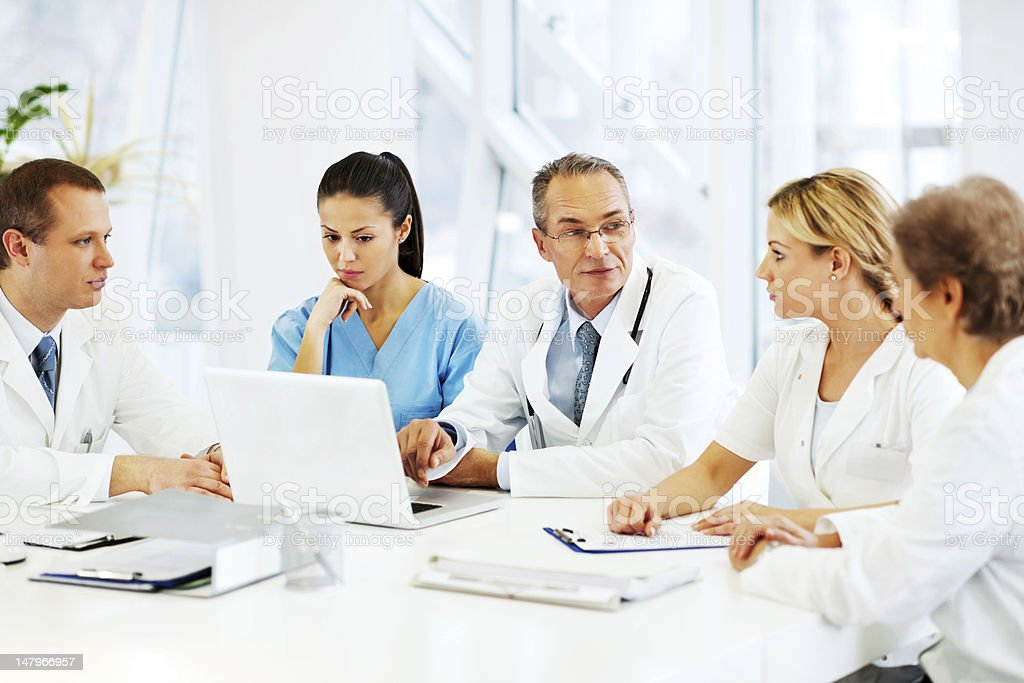 Doctors Collaborating with a medical case. stock photo