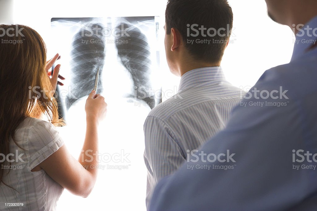 Doctors consult over an x-ray royalty-free stock photo